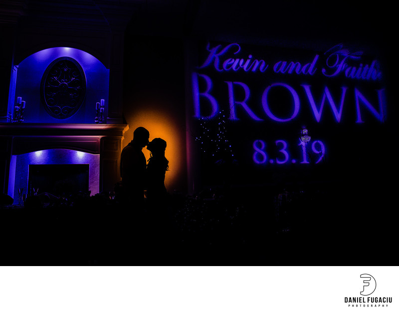 Silhouette of bride and groom in reception room