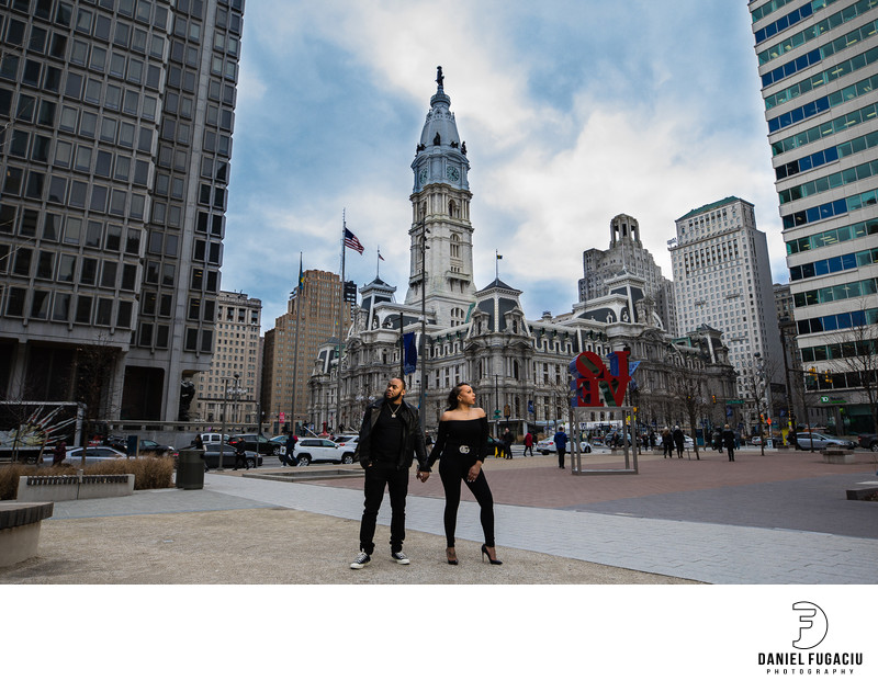 Engaged couple holding hands at Philadelphia City Hall