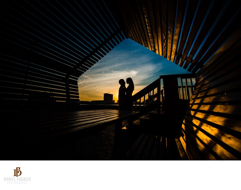 Silhouette of an engaged couple at sunrise