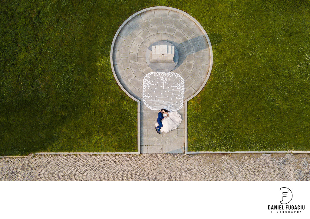 Aerial portrait of bride and groom in the park