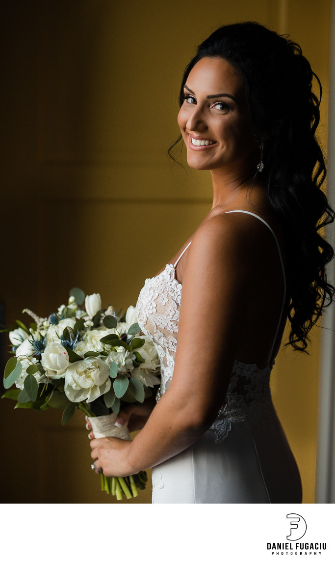Portrait of bride holding flowers during getting ready