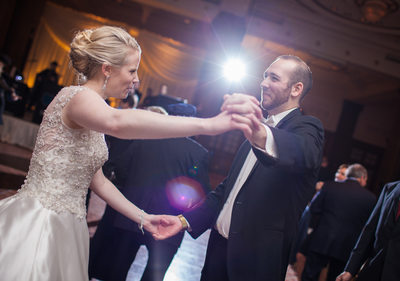 Happy bride and groom dance at Crystal