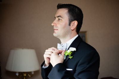 Groom prepping bowtie
