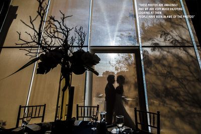 Silhouette of bride and groom before reception