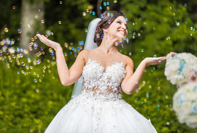 Bride surrounded by soap bubbles