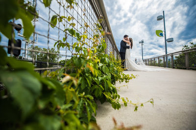 Married couple kissing on Schuylkill River Path