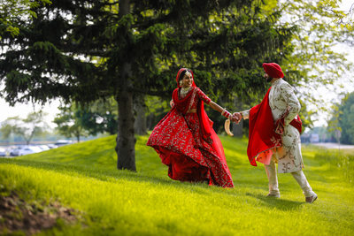 Sikh Indian couple laughing on their wedding day
