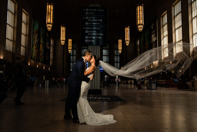 30th Street Station Bride and groom photo kissing