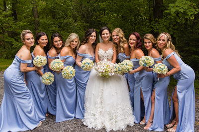 Bridesmaids and bride having fun posing