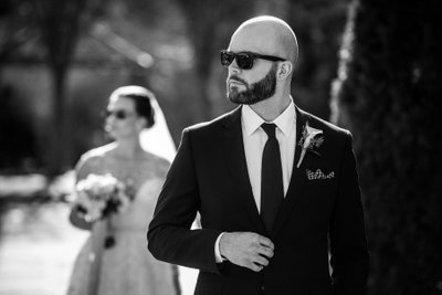 Bride and groom wearing sunglasses b&w