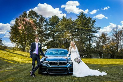 Wedding couple posing with BMW M5