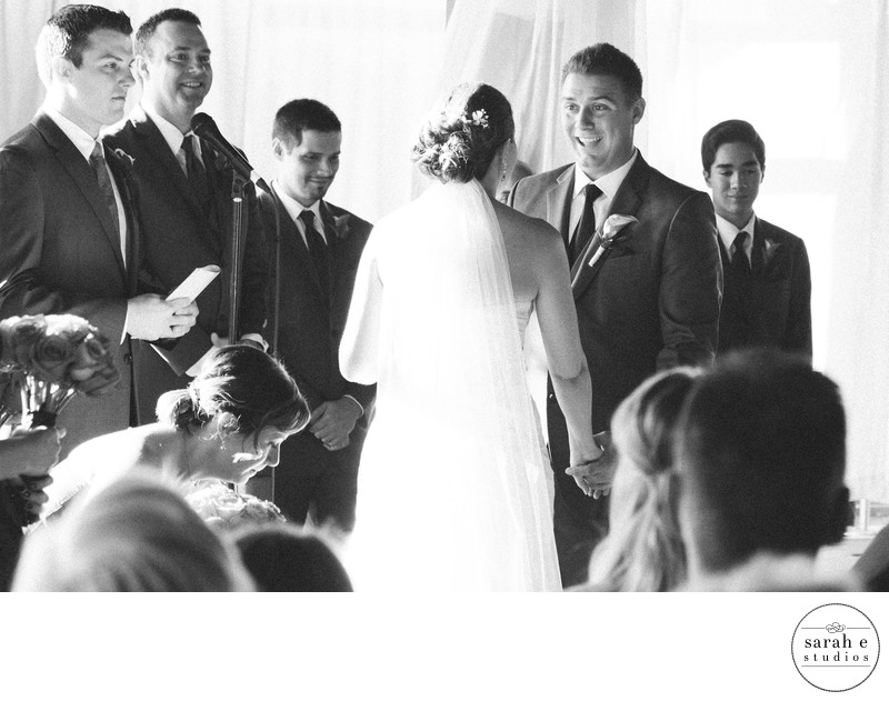 Candid Black and White Wedding Photograph During Ceremony