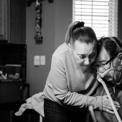 A warm hug for a patient with ALS as documented by Sarah Howell of Sarah E Studios