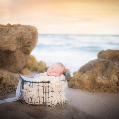 Outdoor natural light photographer newborn baby beach