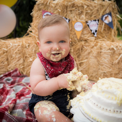 one year baby cowboy cake smash birthday photo Parkland