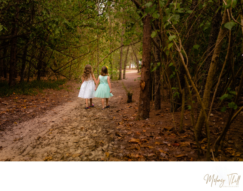 Sisters strolling through the brush at Kualoa Park - Secret Island
