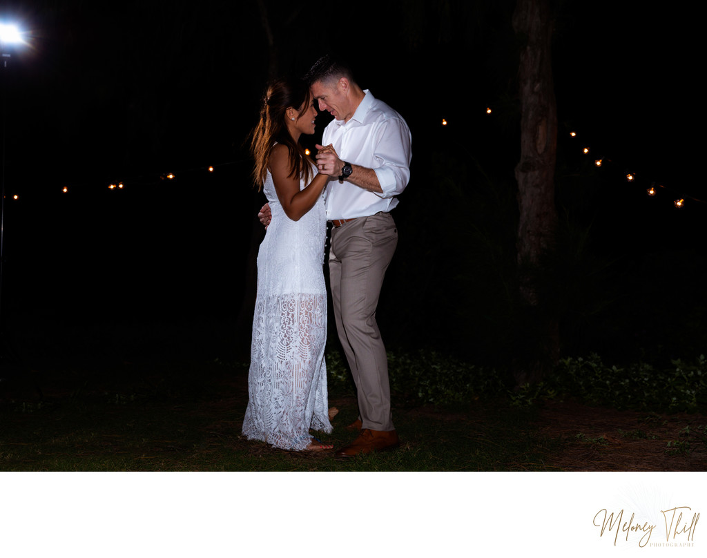 Wedding couple's first dance under the stars - Honolulu Wedding Photographer