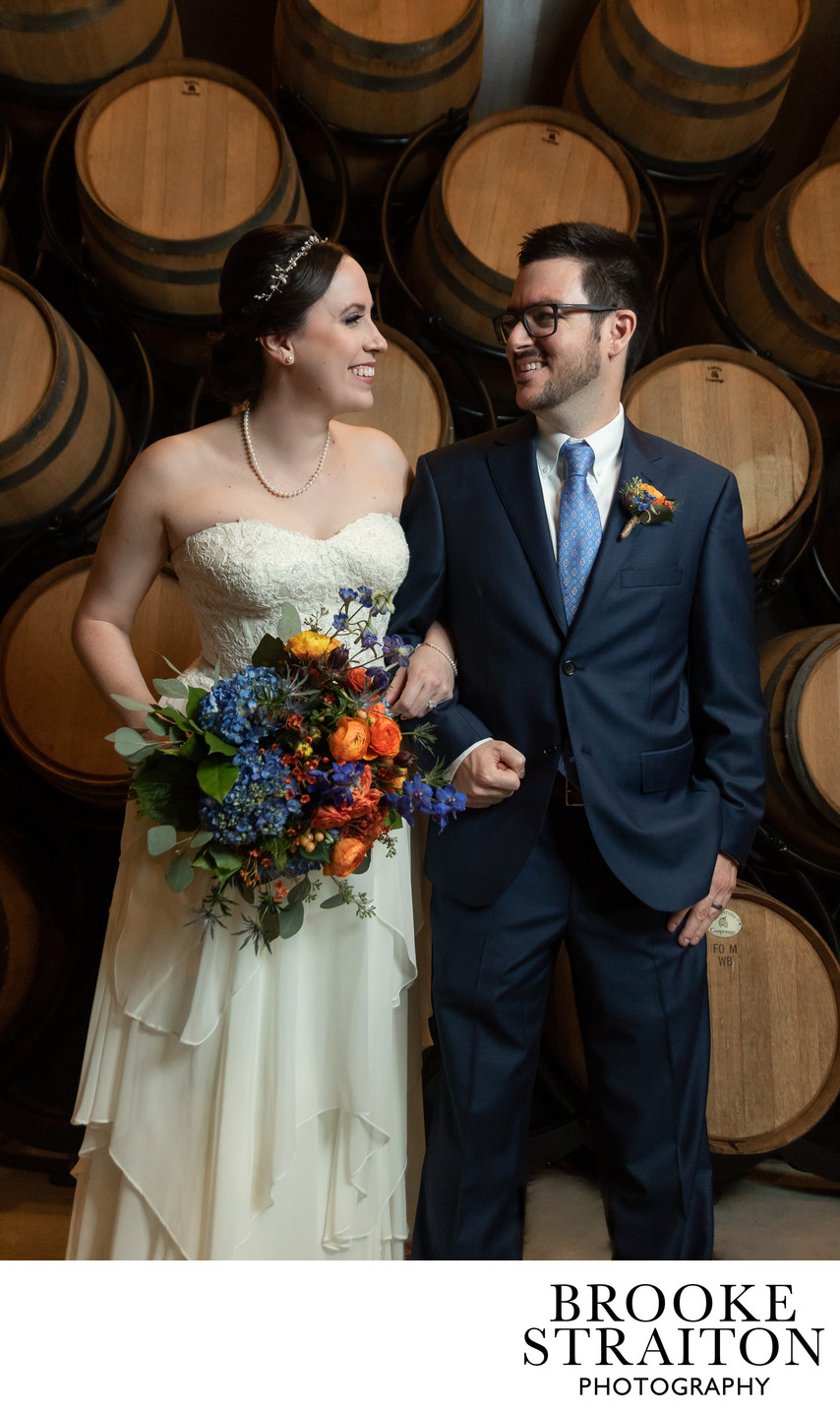 The barrel room with bride and groom