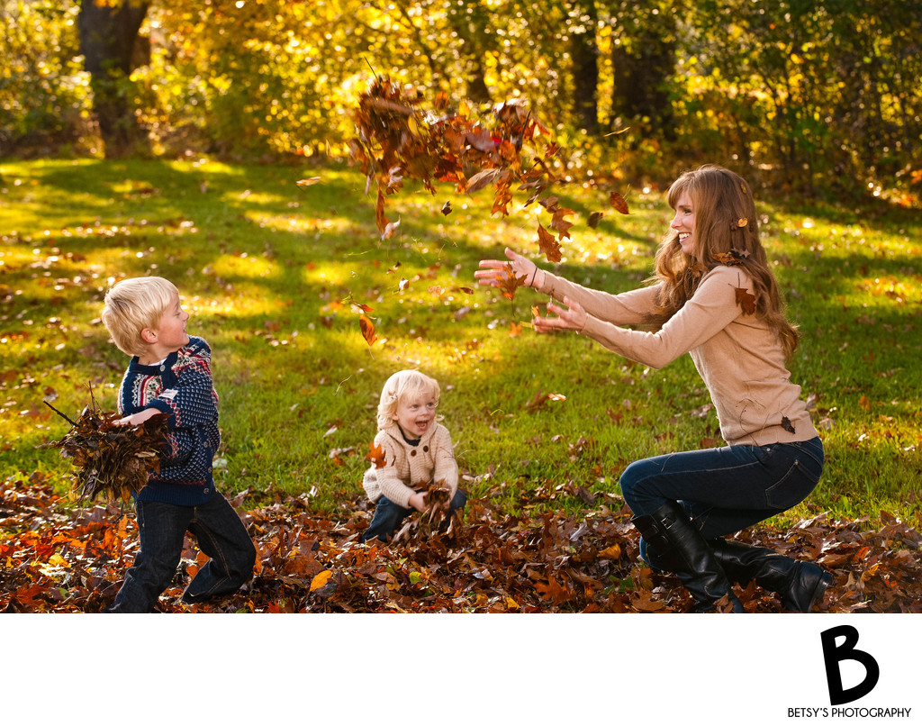 Family Playing in the Leaves - Fall Portrait