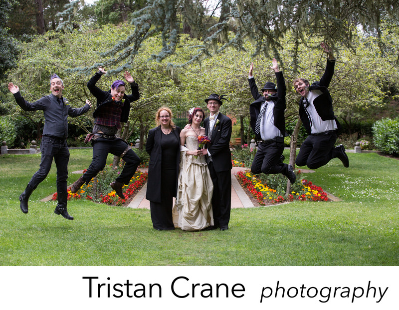 Wedding party jump for joy at the Shakespeare Garden