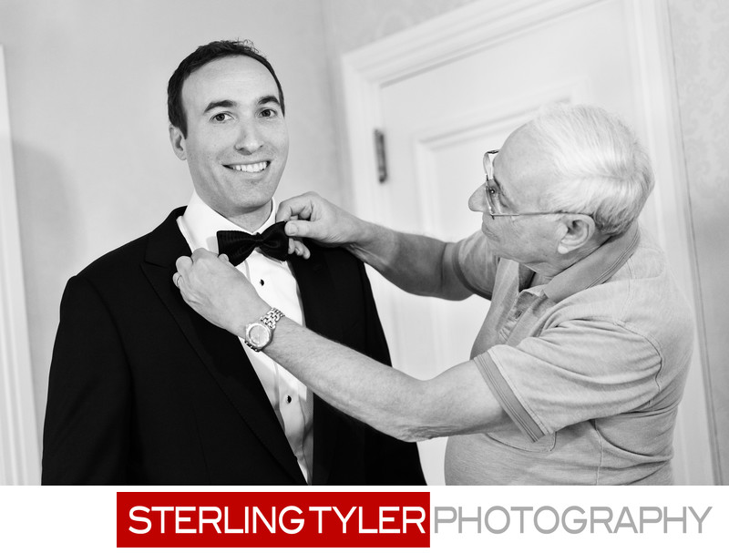 groom getting ready with father wedding photojournalism