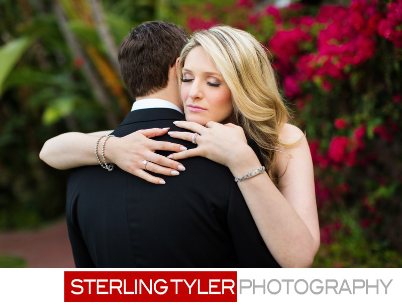 bride hugs groom after ceremony candid wedding photography