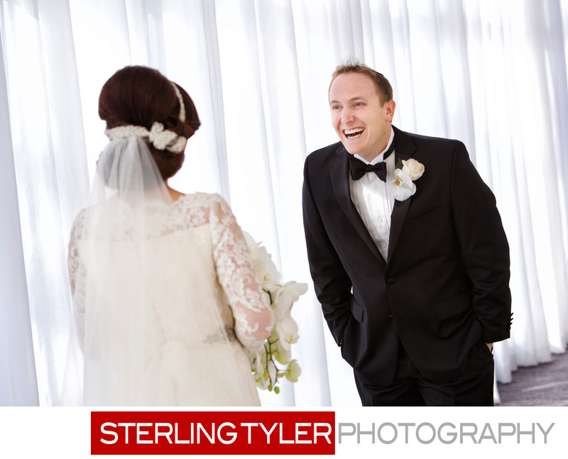 groom laughing with bride at sheraton universal hotel