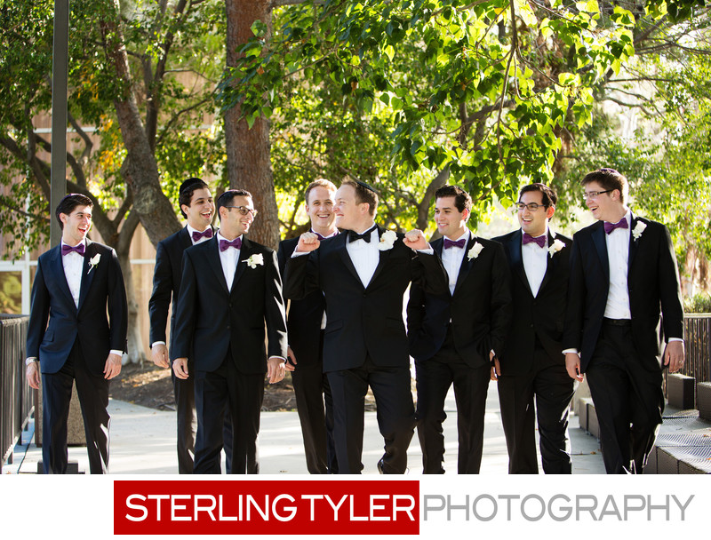 groom with groomsmen laughing wedding photograph