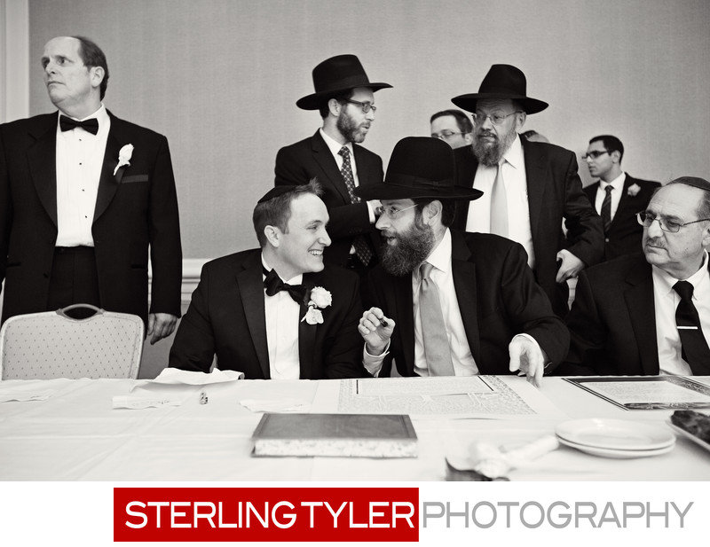 groom at tish with rabbi at orthodox jewish wedding