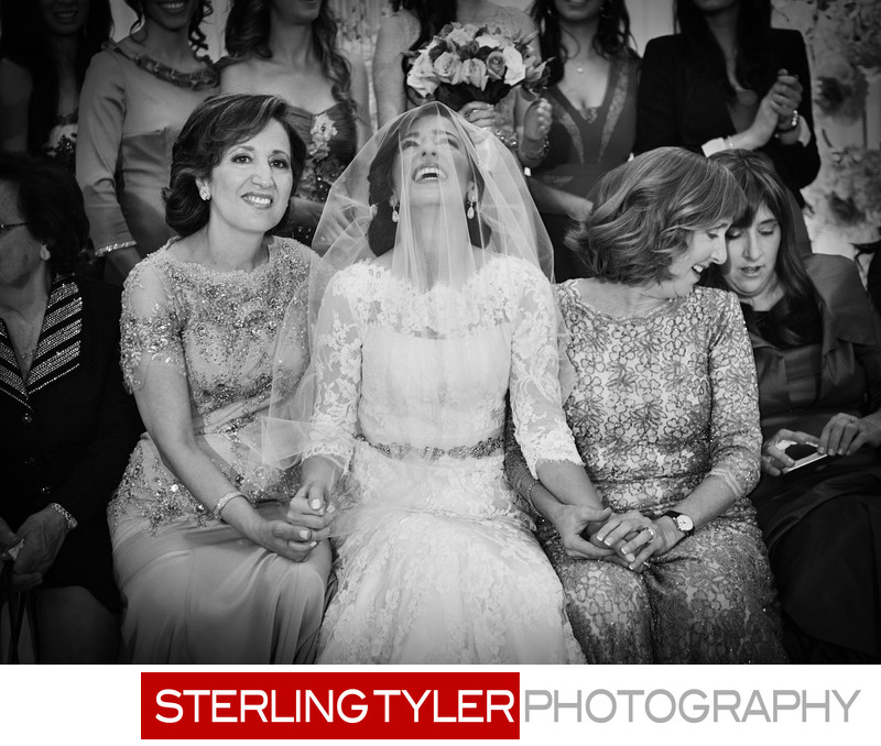 excited jewish bride during bedeken black and white photograph