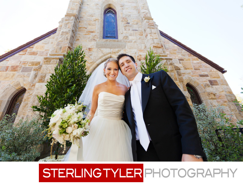bride and groom in front of st helena church napa valley
