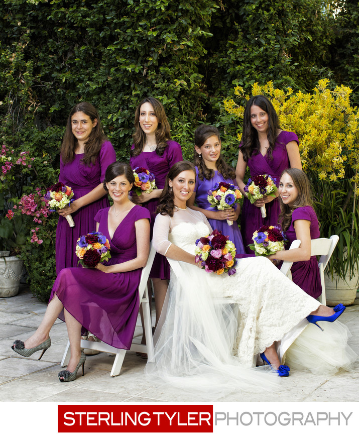 bride with bridesmaids in garden at sephardic temple