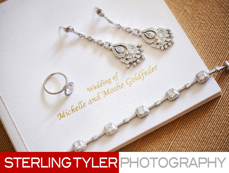 engagement ring and earrings with wedding program