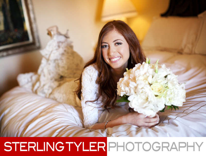 beverly hills bride cute portrait with flowers on bed