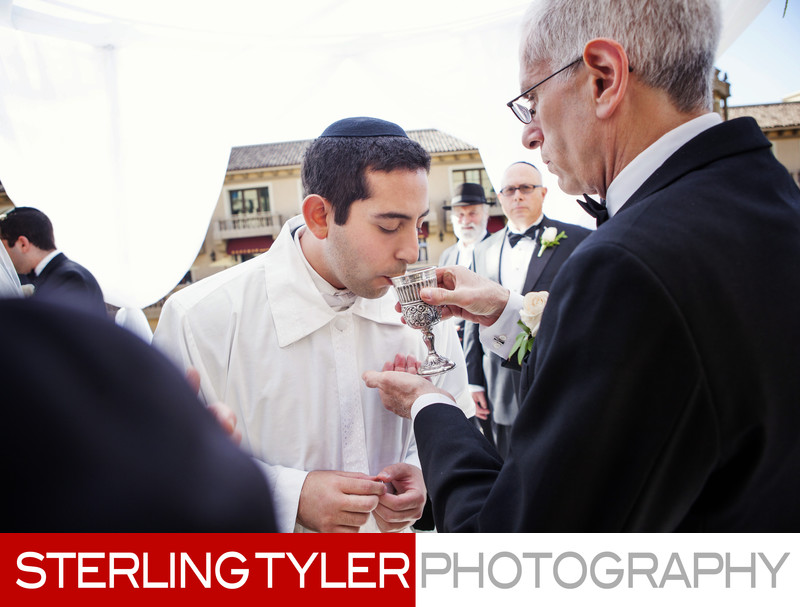 groom drinks wine during jewish wedding beverly hills