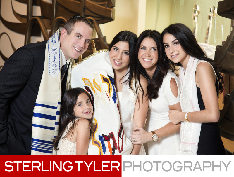 bat mitzvah family portrait with torah at arc