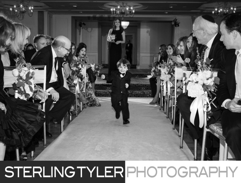 cute ring bearer running wedding journalism