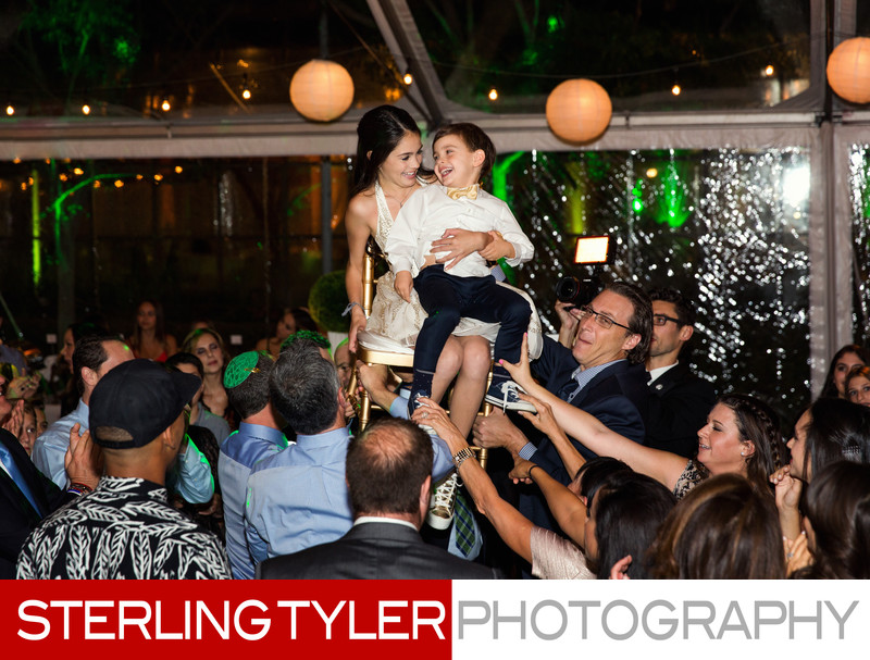 bat mitzvah with little brother during hora
