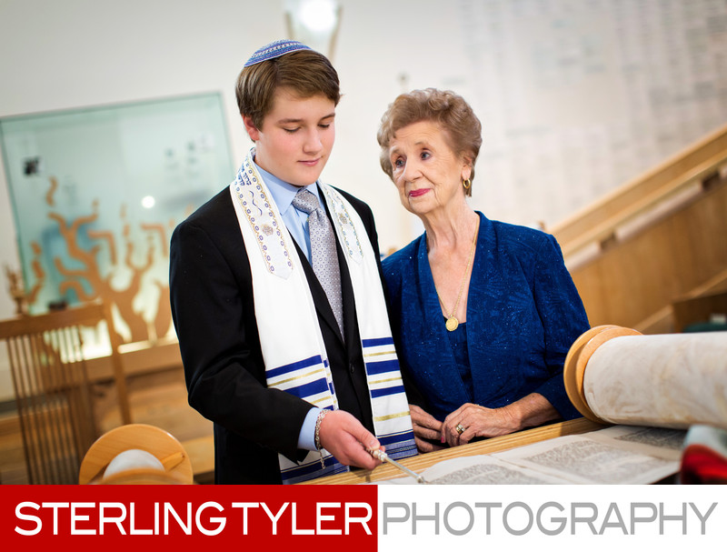 bat mitzvah candid photo with grandmother and torah