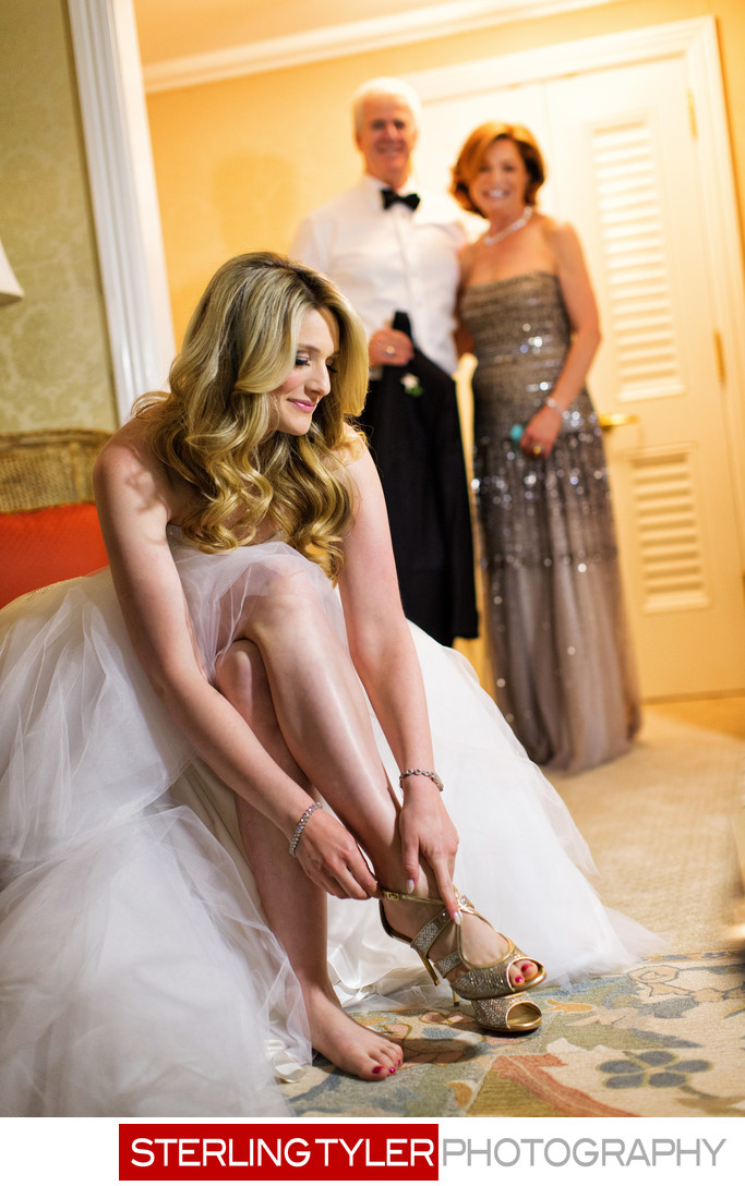bride putting on jimmy choo shoes in beverly hills