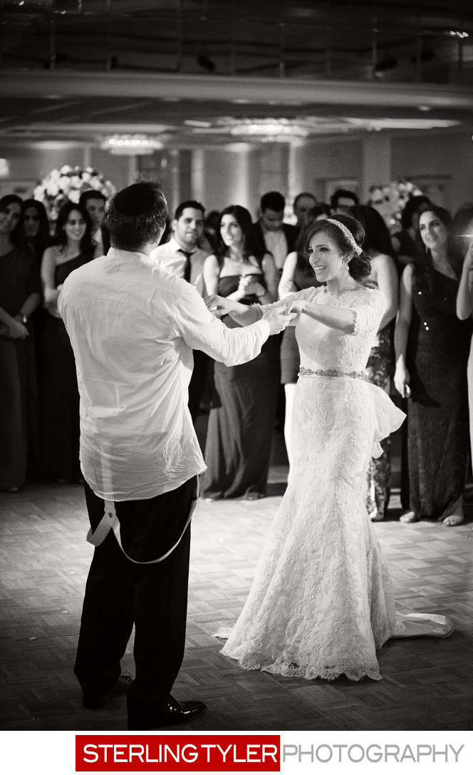 jewish bride and groom dancing photojournalism