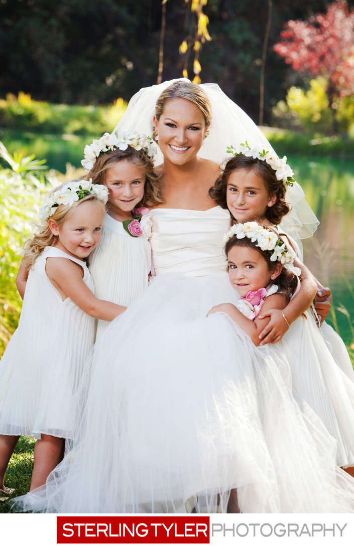 bride with flower girl wearing floral headpieces