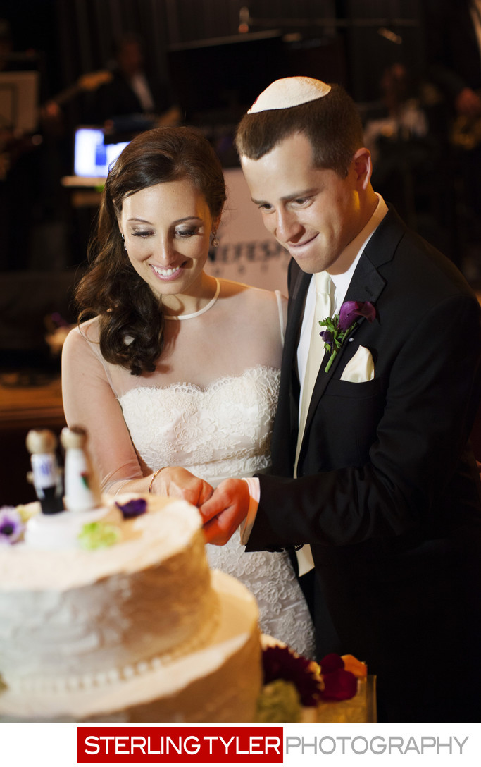 bride and groom cut cake at jewish wedding