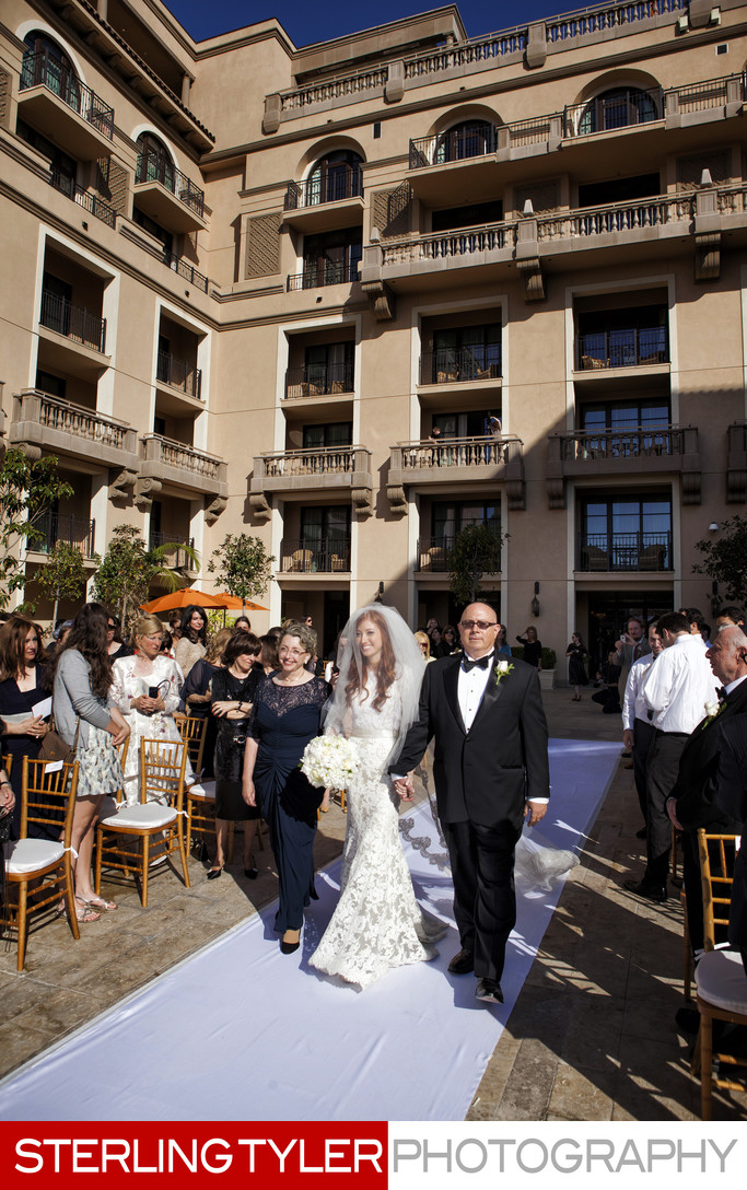 bride walking down aisle at montage hotel beverly hills