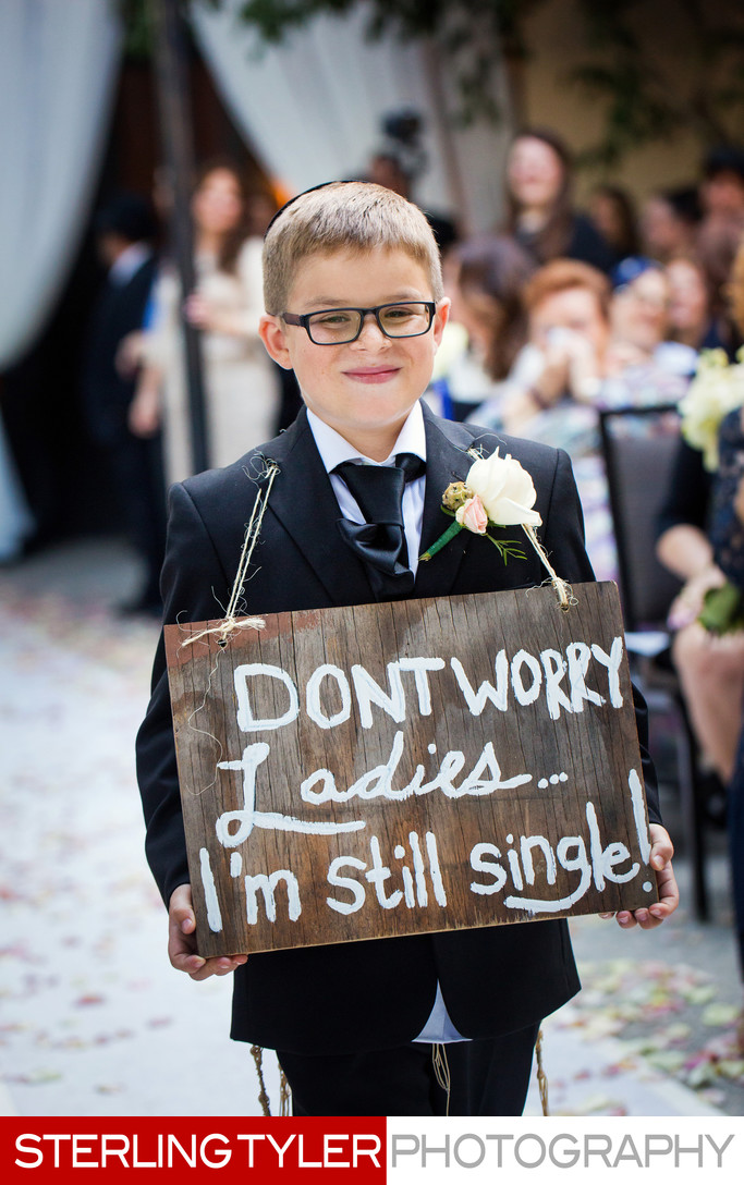 cute ring bearer walks down aisle at westin lax