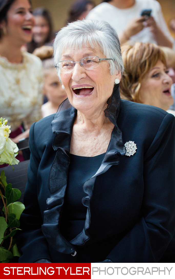 grandma smiling at jewish wedding