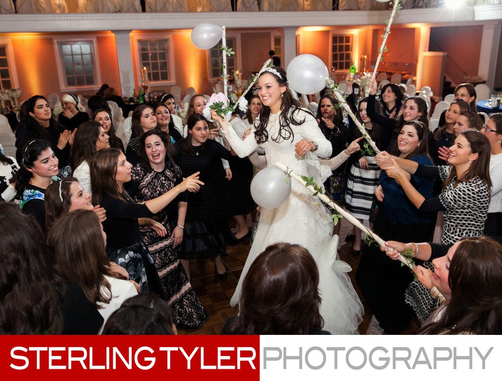 bride dancing with her friends during orthdox jewish wedding reception