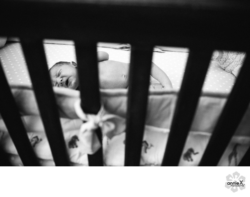 Newborn in crib
