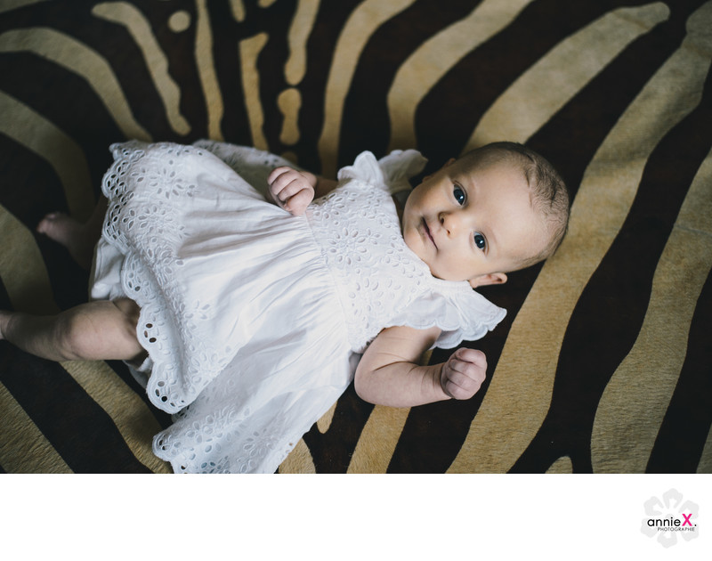 Baby girl on zebra rug in lahontan