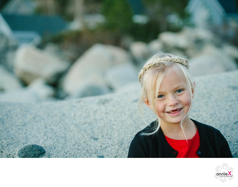 Blond girl toothless smile in Lake Tahoe